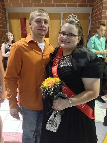 Homecoming King Alex Childers poses with Homecoming Queen Shelby Hill at the dance the evening after being crowned.
