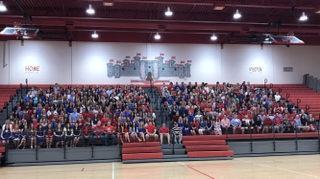 The annual senior picture went smoothly with the help of the help of student council leader Tim James, the principals and history teacher Brian Casto.