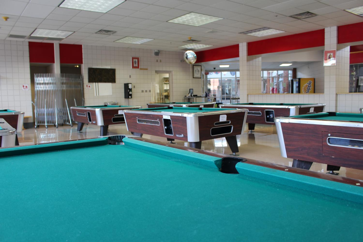 The pool hall, where all new students cling.