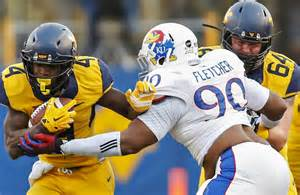 Kansas Jayhawks fighting the West Virginia Mountaineers for the ball during the game this past month.