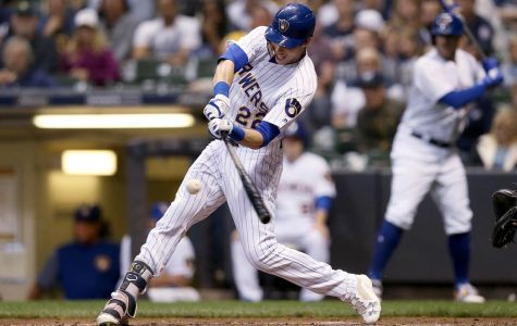 MILWAUKEE, WI - SEPTEMBER 08:  Christian Yelich #22 of the Milwaukee Brewers hits a home run in the fifth inning against the San Francisco Giants at Miller Park on September 8, 2018 in Milwaukee, Wisconsin. (Photo by Dylan Buell/Getty Images)